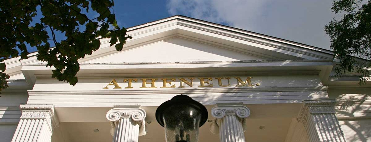 Looking up at the Atheneum entrance showing the greek revival columns.
