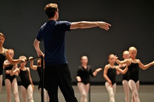 Instructor and youth in ballet class