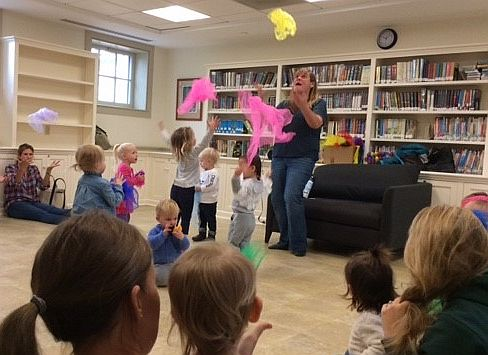 Lizza Obremski tossing handkerchiefs with children
