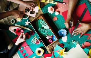 Assortment of craft supplies and shapes being cut out